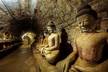 Buddha statues in the underground corridors of Htukkanthein temple, Mrauk U, Rakhine, Myanmar (Burma), Asia