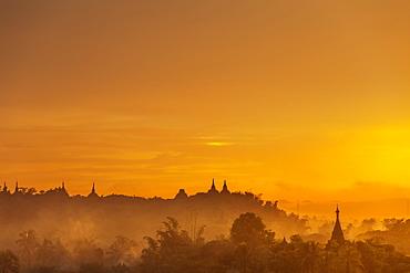 Pagoda spires at sunset, Mrauk U, Rakhine State, Myanmar (Burma), Asia