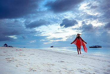 A woman enjoying the beach, The Maldives, Indian Ocean, Asia