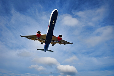 An commercial airliner approaching Phuket International Airport, Thailand, Southeast Asia, Asia