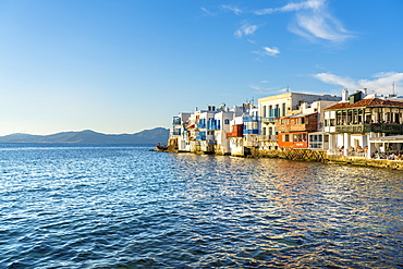 Mykonos Town at sunset with mountains in background, Mykonos, Cyclades, Greek Islands, Greece, Europe