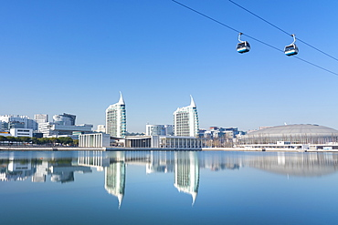 Reflection of Pavilhao de Portugal, Expo 98, with cable car, in Parque das Nacoes (Park of the Nations), Lisbon, Portugal, Europe
