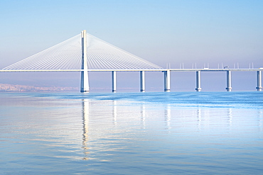 The Vasco da Gama Bridge, a cable-stayed bridge spanning the Tagus River in Parque das Nacoes (Park of the Nations), Lisbon, Portugal, Europe
