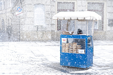 Traditional Krakow bagel seller in the snow located at the City Square, Krakow, Poland, Europe