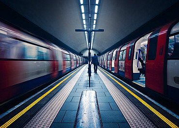 One stationary and one underground train in motion, London Tube Station, Clapham Common, Clapham, London, England, United Kingdom, Europe