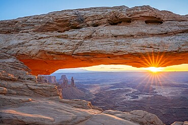 Close up view of canyon through Mesa Arch at sunrise, Canyonlands National Park, Utah, United States of America, North America