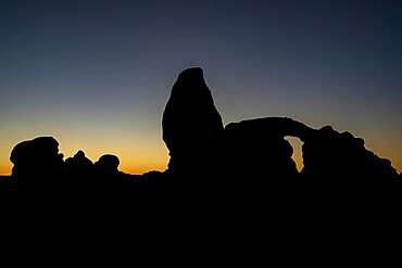 Silhouette of Turret Arch at sunset, Arches National Park, Utah, United States of America, North America