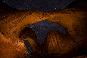 View of stars through Double Arch, Arches National Park, Utah, United States of America, North America