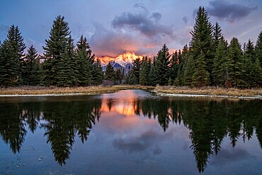First light on the Grand Tetons with reflection at Schwabacher's Landing, Grand Teton National Park, Wyoming, United States of America, North America