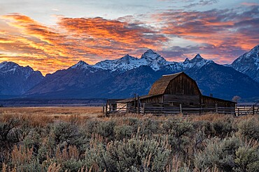 Sun setting over the Teton Range at Moulton Barn, Grand Teton National Park, Wyoming, United States of America, North America