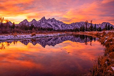 Sunset and reflection of Teton Range in Snake River at Schwabacher's Landing, Grand Teton National Park, Wyoming, United States