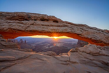 Sunrise at Mesa Arch with glowing arch and sunburst, Canyonlands National Park, Utah, United States of America, North America