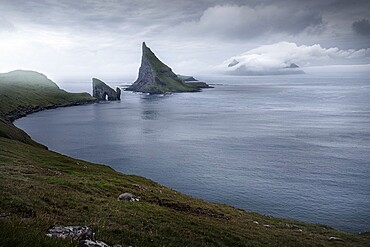 View over the bay with Drangarnir and Tindholmur, Faroe Islands, Denmark, Europe