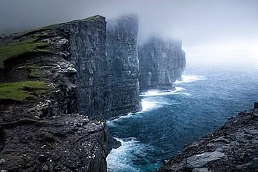 Cliffs of Traelanipa above the ocean, Faroe Islands, Denmark, Europe