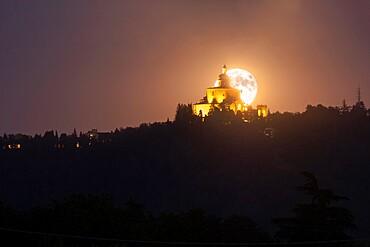 Full moon rising behind San Luca Basilica in Bologna, Emilia Romagna, Italy, Europe