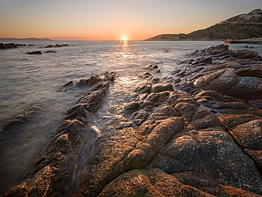 Sunset on the sea and rocks, Antiparos Island, Cyclades, Greek Islands, Greece, Europe