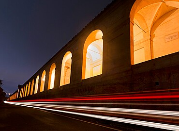 Car light trails and the porticoes of Bologna, Bologna, Emilia Romagna, Italy, Europe
