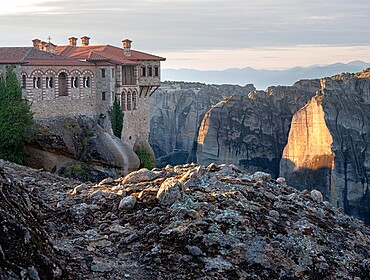 Varlaam Monastery and sunrise light on Meteora's rocks, Meteora, UNESCO World Heritage Site, Thessaly, Greece, Europe