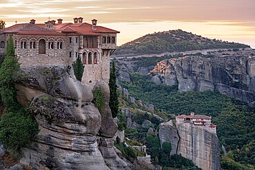 Varlaam and Roussanou (St. Barbara) Monasteries at sunrise, Meteora, UNESCO World Heritage Site, Thessaly, Greece, Europe