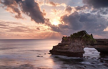 Sunset on Batu Bolong temple on a natural arch in the sea, Bali, Indonesia, Southeast Asia, Asia