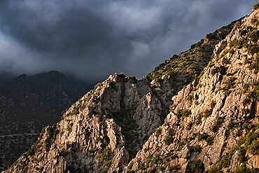 Sunset light on a rocky mountain and dark clouds in the sky, Chefchaouen, Morocco, North Africa, Africa