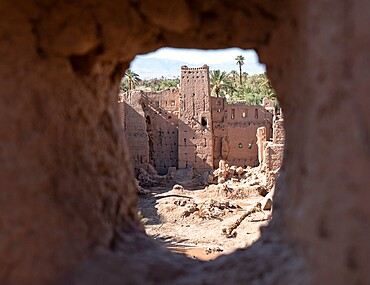 Kasbah ruins seen through an ancient kasbah window, Morocco, North Africa, Africa