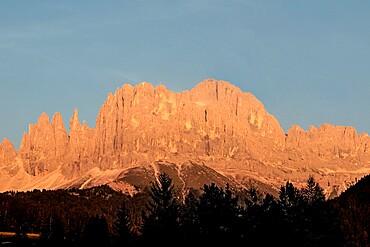 Orange sunset named enrosadira on Catinaccio mountain, Val di Tires, Bolzano, Italy, Europe