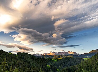 Sunset on Catinaccio mountain in the Dolomites and cloud cover, Trentino-Alto Adige, Italy, Europe