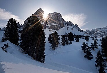 Dolomites snowy winter landscape of the Sass the Putia with a sun star between rocks, Trentino-Alto Adige, Italy, Europe