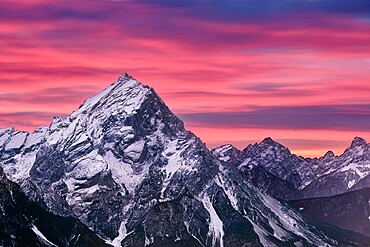 Pink sunset on Antelao mountain in winter with snow, Dolomites, Trentino-Alto Adige, Italy, Europe