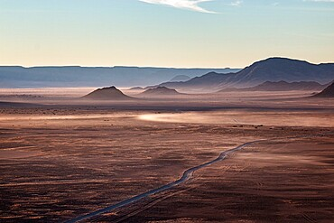 Rocky desert at sunrise photographer from a baloon flying over it, Namibia