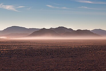 Misty sunrise in the rocky desert, Namibia, Africa