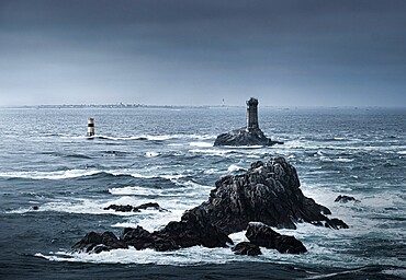 View of the ocean at Pointe du Raz with two lighthouses, Phare de la Vieille and Tourelle de la Plate (Petite Vieille), in the sea and rocks, Finistere, Brittany, France, Europe