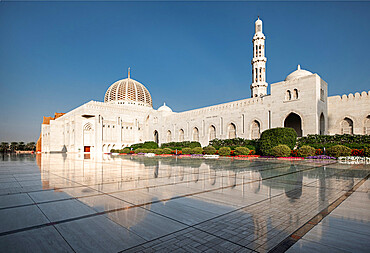 Sultan Qaboos mosque reflected in the shiny marble floor, Muscat, Oman