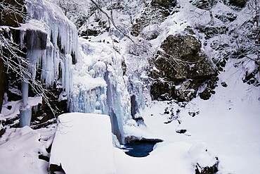 Frozen Dardagna waterfalls in winter with snow, Parco Regionale del Corno alle Scale, Emilia Romagna, Italy, Europe