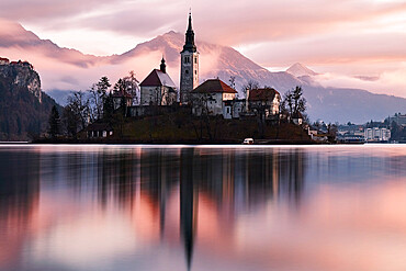 A church in the island in the middle of Bled lake at sunrise, Slovenia, Europe