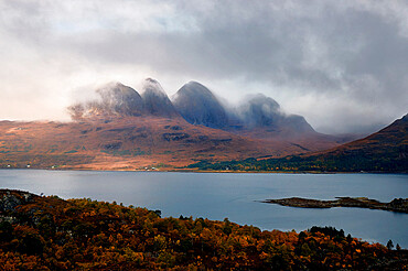 Mountains in the mist facing a lake in the Scottish Highlands, Scotland, United Kingdom, Europe