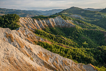 Badlands amphitheater with lush hills, Emilia Romagna, Italy