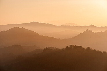 Sunset light reflected in the midst on countryside hills, Emilia Romagna, Italy