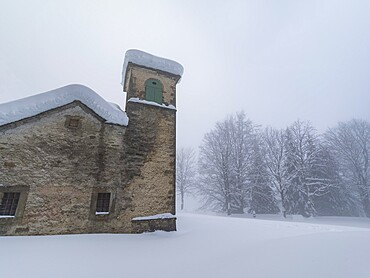 Shrine of Madonna dell'Acero covered by snow, Parco Regionale del Corno alle Scale, Emilia Romagna, Italy, Europe