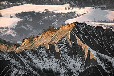 Badlands covered by the fist snow, Emilia Romagna, Italy, Europe