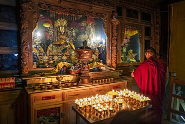 A Buddhist monk praying in the Bati temple, Gansu, China, Asia