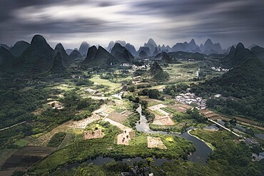 Long exposure of Yangshuo mountains with dark clouds, Yangshuo, Guangxi, China, Asia