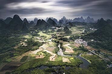 Long exposure of Yangshuo mountains with dark clouds, Yangshuo, Guangxi, China, Asia