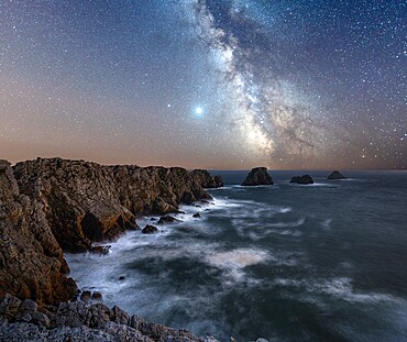 Long exposure of the Milky Way above the cape of Pen Hir, Brittany, France, Europe