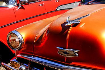 Close view of hood and hood ornament on an antique car, Havana, Cuba