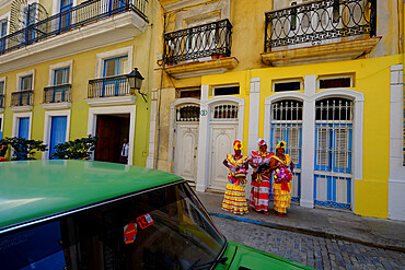 Three colorful ladies in traditional dress, Old Havana, Cuba, West Indies, Central America