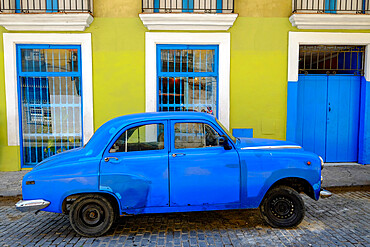 Old car parked in front of a colorful building, Old Havana, Cuba, West Indies, Central America