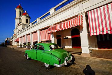 Vintage car parked along the street with Catedral de la Purisima Concepcion, Cienfuegos, UNESCO World Heritage Site, Cuba, West Indies, Central America