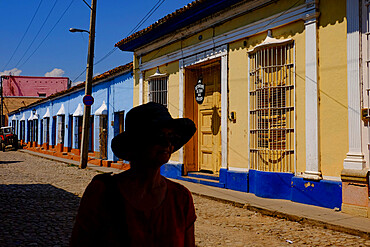The silhouette of a woman on a quiet street, Trinidad, Cuba
